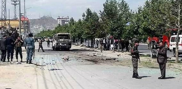 Two people were killed and dozens more wounded in Kabul on Sunday as a wave of bombings hit civilian targets including a university school bus across the Afghan capital.