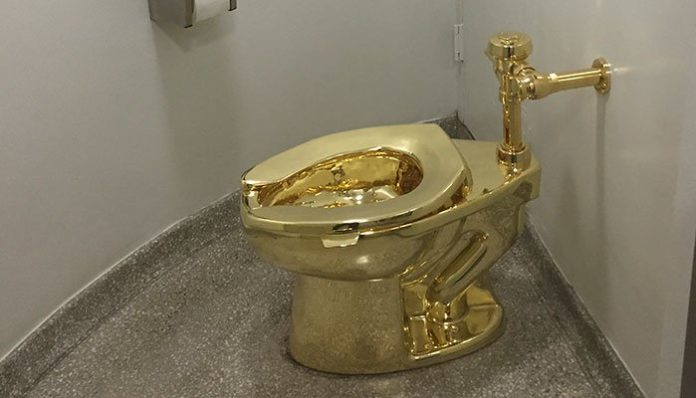 In this file photo taken on September 15, 2016, a fully functioning solid gold toilet, made by Italian artist Maurizio Cattelan, is going into public use at the Guggenheim Museum in New York